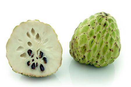 sweetsop: Custard-Apple (Annona Squamosa) . Whole fruit and cross-section, showing creamy white flesh and dark seeds. Shot on white