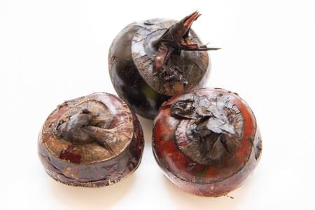three water chestnuts on white dish