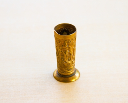 Old brass vase on white wooden board Stock Photo - 16923591