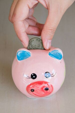 saving money on a piggy bank photo