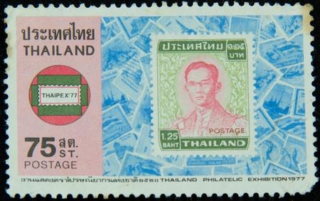 ix portrait: A stamp printed in Thailand shows portrait of Bhumibol Adulyadej Rama IX of Thailand (glasses)