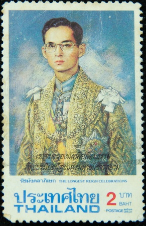 A stamp printed in Thailand shows portrait of Bhumibol Adulyadej Rama IX of Thailand (glasses), circa 1951-1960