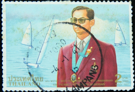 bhumibol: A stamp printed in Thailand shows portrait of Bhumibol Adulyadej Rama IX of Thailand,70th Anniversary of His Majesty King Bhumibol Adulyadej 1997