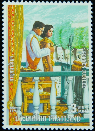 bhumibol: A stamp printed in Thailand shows portrait of Bhumibol Adulyadej Rama IX of Thailand ,Golden jubilee, circa 1996 Editorial