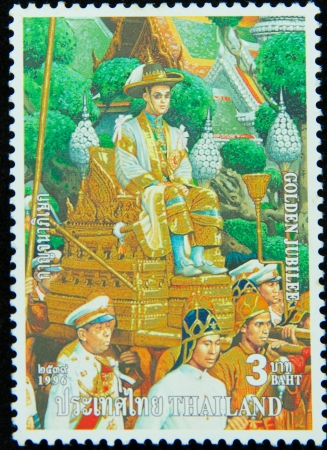 ix portrait: A stamp printed in Thailand shows portrait of Bhumibol Adulyadej Rama IX of Thailand ,Golden jubilee, circa 1996 Editorial