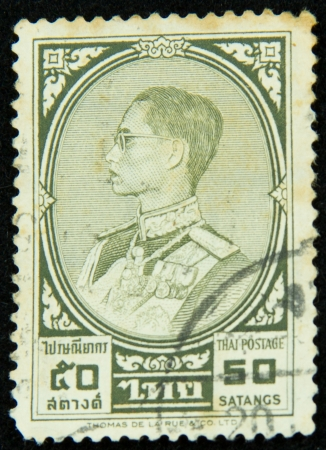 A stamp printed in Thailand shows portrait of Bhumibol Adulyadej Rama IX of Thailand Stock Photo - 17003396
