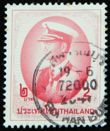 A stamp printed in Thailand shows portrait of Bhumibol Adulyadej Rama IX of Thailand Stock Photo - 17003386