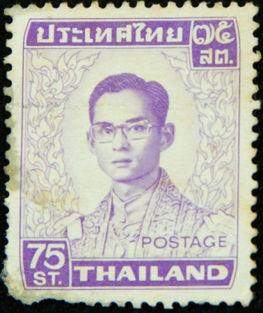 A stamp printed in Thailand shows portrait of Bhumibol Adulyadej Rama IX of Thailand Stock Photo - 17003389