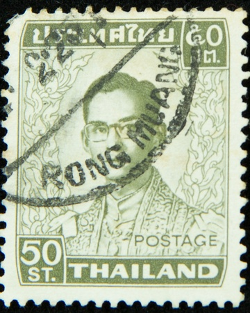 A stamp printed in Thailand shows portrait of Bhumibol Adulyadej Rama IX of Thailand Stock Photo - 17003391