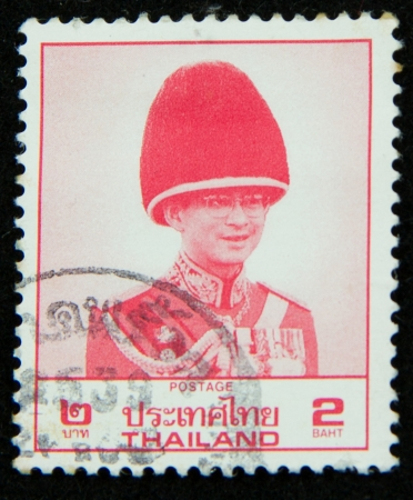 A stamp printed in Thailand shows portrait of Bhumibol Adulyadej Rama IX of Thailand Stock Photo - 17003388