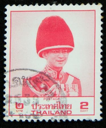 A stamp printed in Thailand shows portrait of Bhumibol Adulyadej Rama IX of Thailand Stock Photo - 17003388