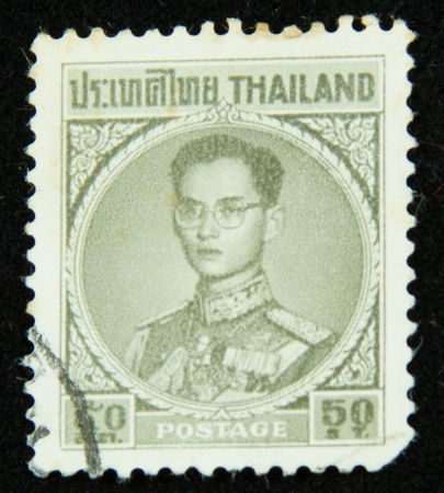 A stamp printed in Thailand shows portrait of Bhumibol Adulyadej Rama IX of Thailand Stock Photo - 17003387