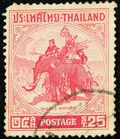 sello antiguo cuenta tailandés rey Naresuan (1555-1605) montado en un elefante de guerra, Tailandia, circa 1955 Foto de archivo