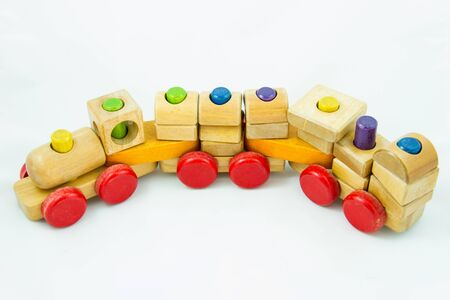 Wooden toy train with colorful blocs on white background Stock Photo - 17011986