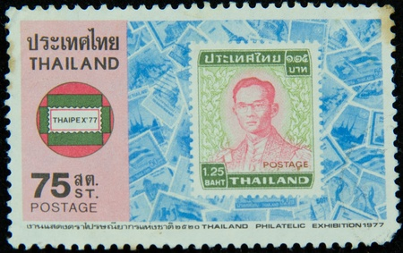 A stamp printed in Thailand shows portrait of Bhumibol Adulyadej Rama IX of Thailand (glasses)