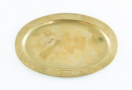 Antique brass tray isolated on white,Top view Stock Photo