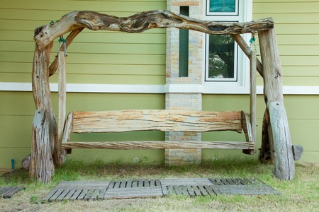 Old wooden swing and green house background Stock Photo - 17143054