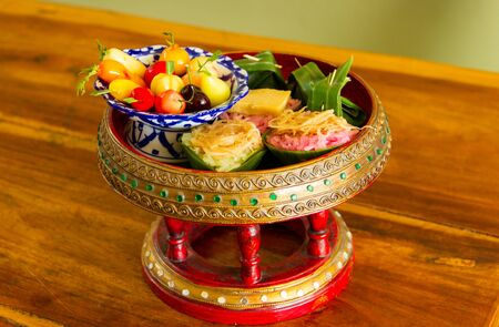Thai dessert in tray on wood floor