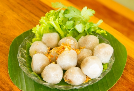 Tapioca Dumplings with Pork in dish on banana leaves photo