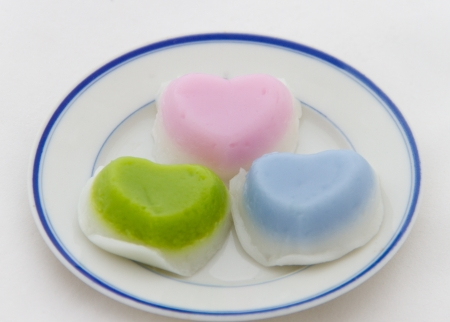 Thai layer cake heart-shaped place on white dish