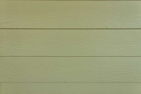 Background of a grunge green wooden wall photo
