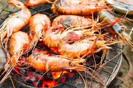 Seafood barbecue of grilled Shrimps on charcoal oven photo