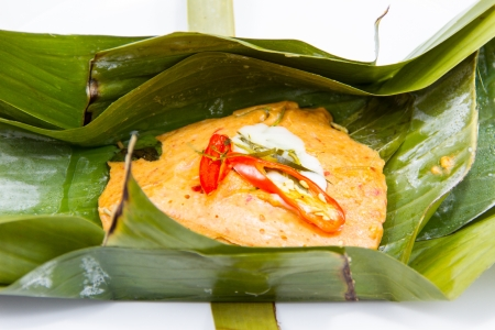 Steamed fish with curry paste in banana leaves