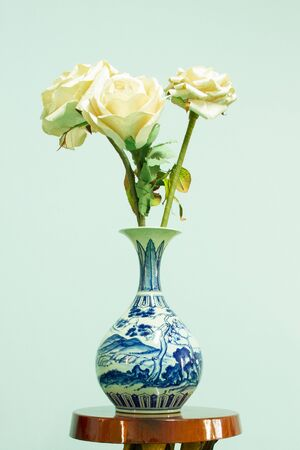 Flower vase on a wooden table photo