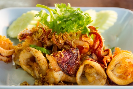 Fried squid with garlic with coriander Stock Photo