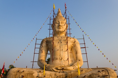 Buddha statue with blue sky and under construction Stock Photo - 19504045
