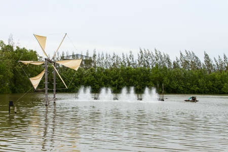 Wind turbine and water turbine,Thailand Stock Photo