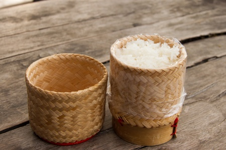 Rice wicker on wooden table photo