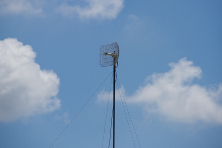 TV antenna,Blue sky and white clouds photo