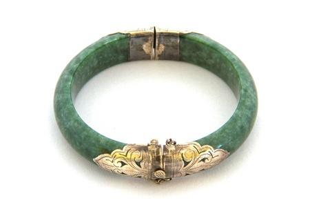 emerald stone: Old jade bracelet on white background Stock Photo