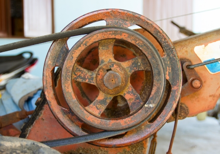 Old pulley and belt of the Agricultural engines photo