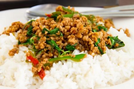 Basil fried rice on white dish