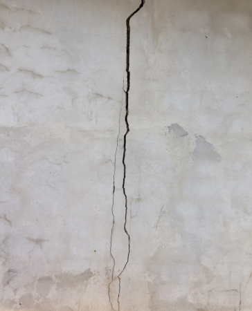 Cracks on the wall,Brick and plaster wall crack