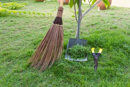 Broom and dustpan is in the garden