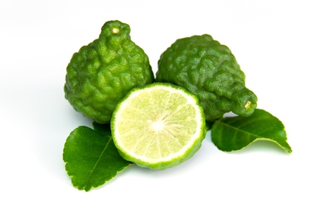 Bergamot and kaffir lime leaves on white background Banque d'images