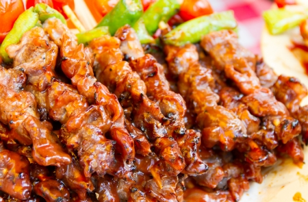 Barbecue with delicious grilled meat on dish photo