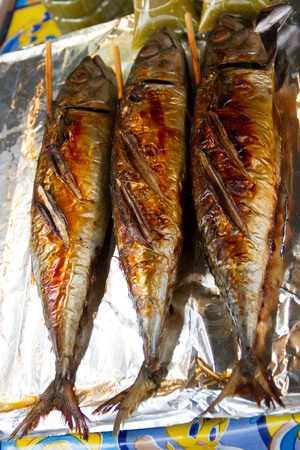 Grilled saba fishes sold in Thai market photo