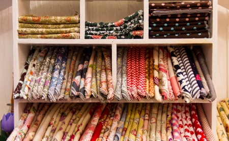 handkerchief on shelves in shop for sell Stock Photo