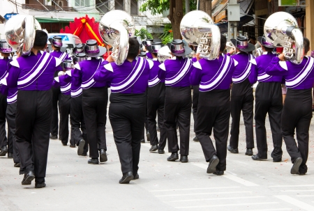 school band: marching band during parade on the celebration