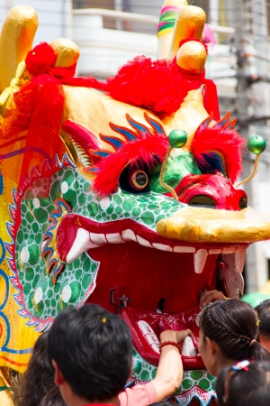 chinese new year dragon: people paying for dragon dance