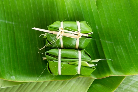 Glutinous rice steamed in banana leaf(Khao Tom Mat or Khao Tom Pad)bananas and sticky rice inside photo