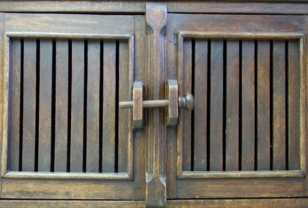 Wooden door latch on Antique wooden cabinets photo
