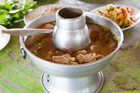 Hot and sour soup pork in pot photo