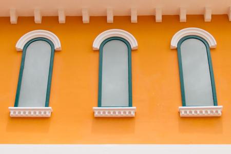 White window on a yellow wall photo