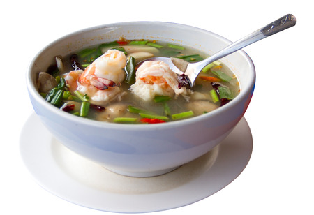 Tom Yum Goong in white bowl photo