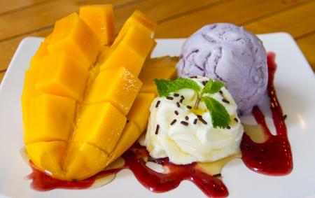 Taro ice cream with ripe mango photo